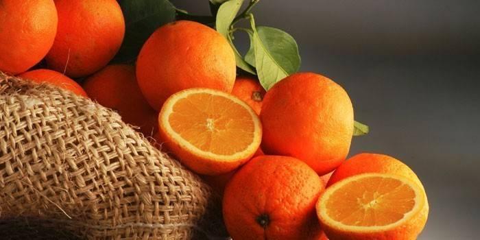 Апельсины целые и половинки