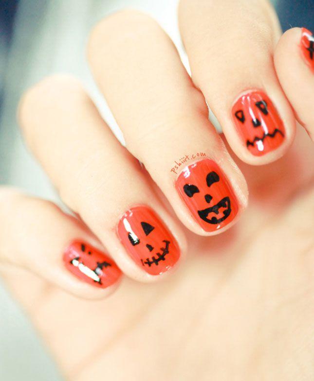 Рисунок на ногтях, изображающий мордочки тыквы