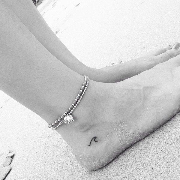 Вариант аккуратной маленькой татуировки