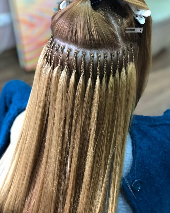 вплетение нарощенных волос